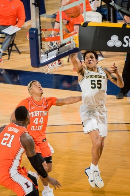 Michigan Guard Eli Brooks (55) Gets by Two Illinois Defenders for a Lay-up.