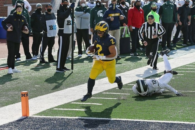 Michigan Running Back Blake Corum (2) Gets by a Michigan State Defender for a Touchdown.