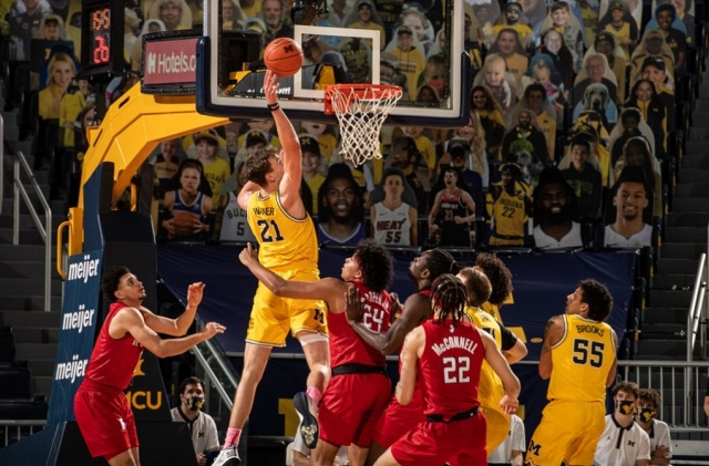 Michigan Guard Franz Wagner (21) Gets to the Basket for a Dunk.